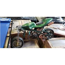 Green pocket bike needs pull cord, said to be able to roll start