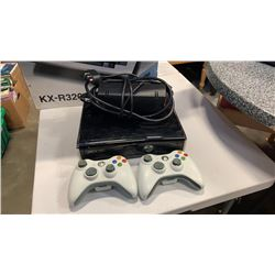 Xbox360 console with two controllers