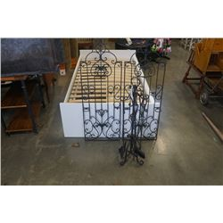 Two decorative metal candle holders and companionset