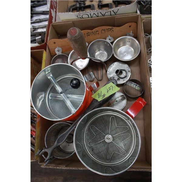 Box of Sifters, cookie cutters, measuring cups & juicer