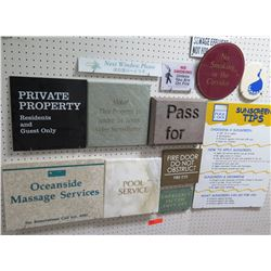 Multiple Signs: Private Property, Pass For, Sunscreen Tips, No Smoking, etc