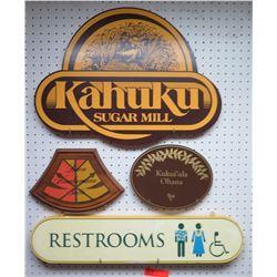 Multiple Signs: Kahuku Sugar Mill, Restrooms, Kukui'ula Ohana, etc
