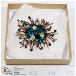 RHINESTONE FLOWER BURST BROOCH