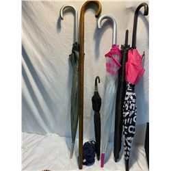 Lot of umbrellas and a wood cane