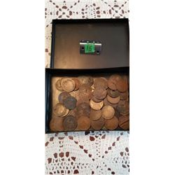 container of large pennies some holed