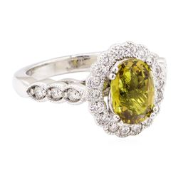3.17 ctw Oval Mixed Yellow Sapphire And Round Brilliant Cut Diamond Ring - 14KT