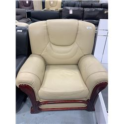 Wood Trimmed Ivory Leather Sofa chair ( small tear on back)