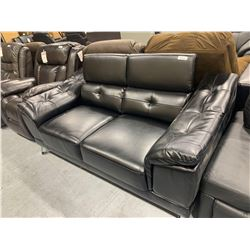 Black Leather Double Seater Loveseat with adjustable head rests and oversized arms