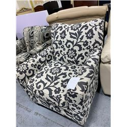 Upholstered black  white floral print sofa chair