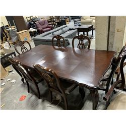 Large ornate Dining Table with 6 matching chairs ( 2 captains  4 side) includes 2 leafs, floor model