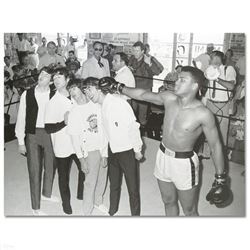 """Muhammad Ali Punching The Beatles"" Photograph"