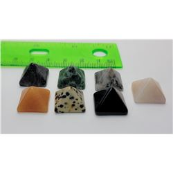 16)  LOT OF 7 PYRAMID SHAPED HEALING STONES