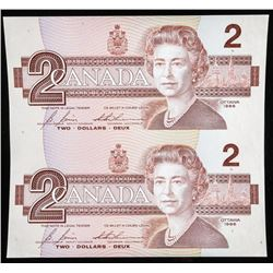 Lot of (2) Uncut 1986 Notes. 2.00. Matched  Last Three Numbers.