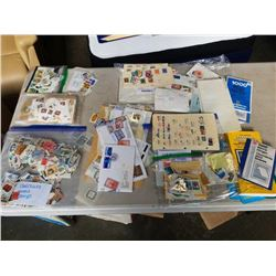 LOT OF CANCELLED STAMPS AND STAMPS ON PAPER - WORLD STAMPS, USA AND CANADA STAMPS