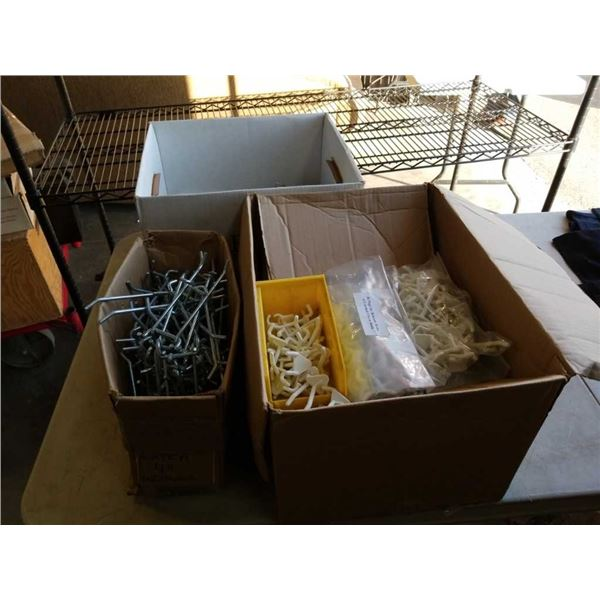 Three boxes of pegboard hooks and other hooks