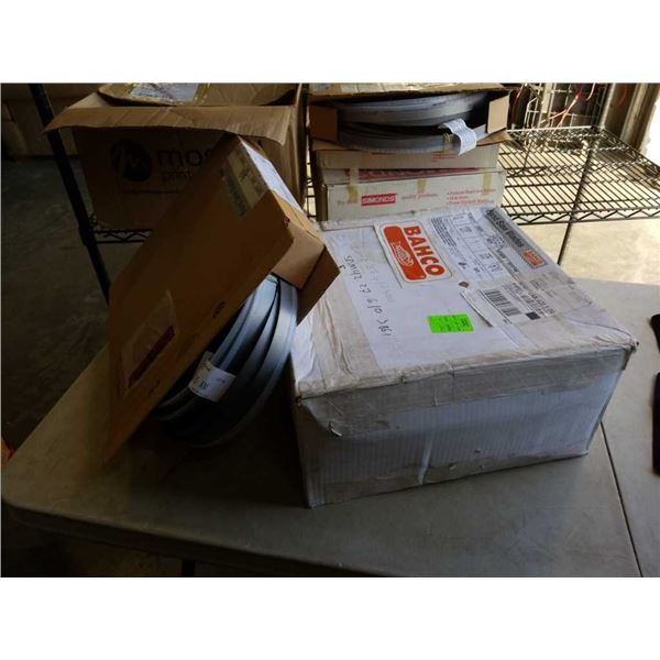 Two boxes of new bandsaw blades