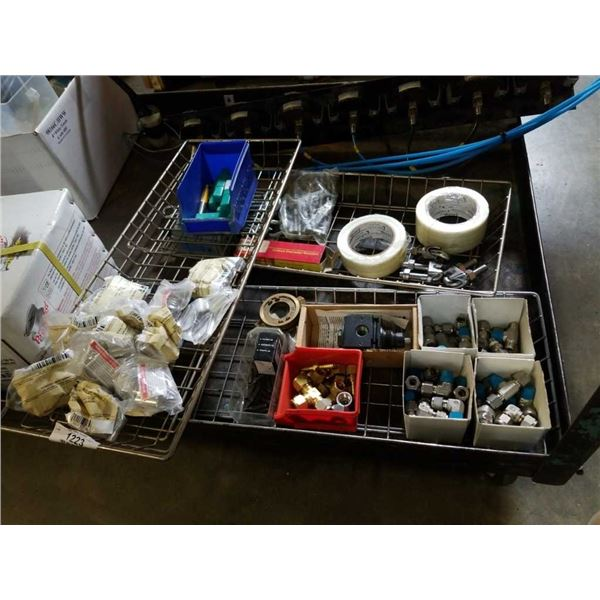 Three trays of air fittings wire clamps glass tape and more