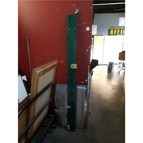 "Green 6.5"" tall expandable security gate"