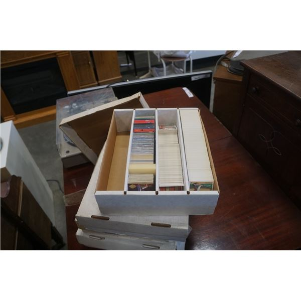 4 large boxes of sports cards
