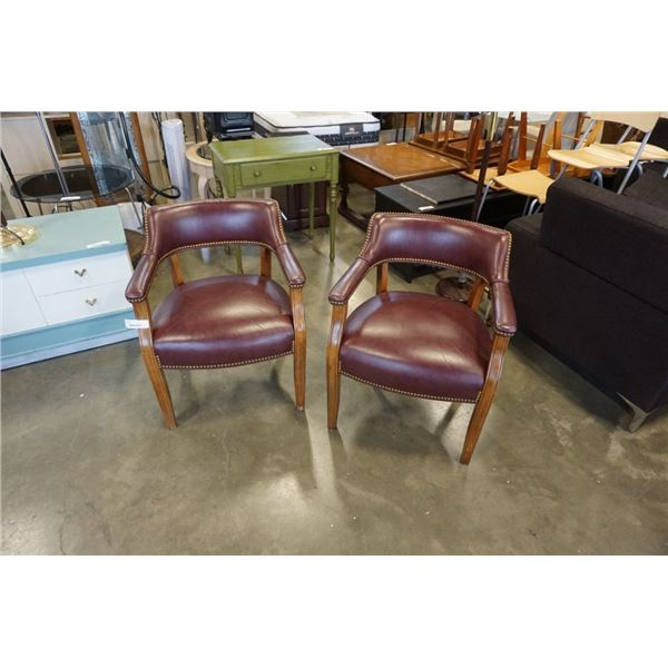 2 PHILIPS FURNITURE CO STUDDED LEATHER ARMCHAIRS