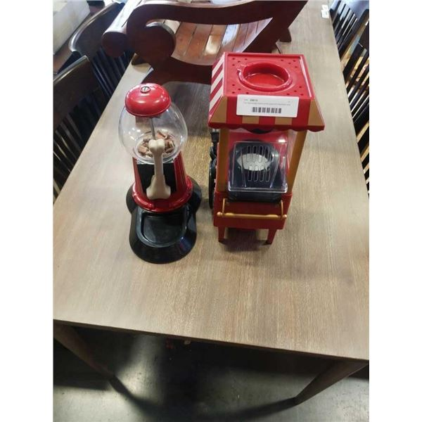 Old fashioned movie time popcorn machine and dog biscuit dispenser