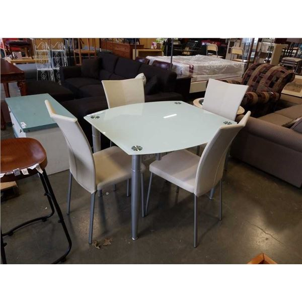 GLASSTOP DINING TABLE WITH SWIVEL OUT LEAFS AND 4 LEATHER CHAIRS RETAIL $1899