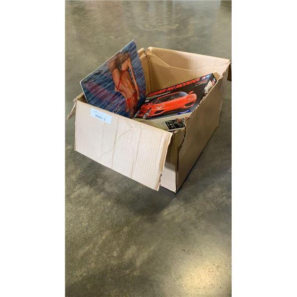Box of ferrari model, cheerleader calendar and more