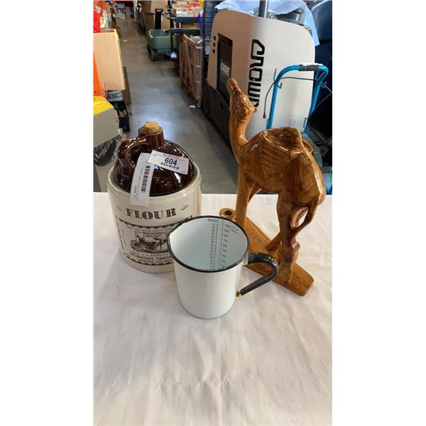 FLOUR JUG WITH CORK, ENAMEL MEASURING CUP AND WOOD CAMEL FIGURE