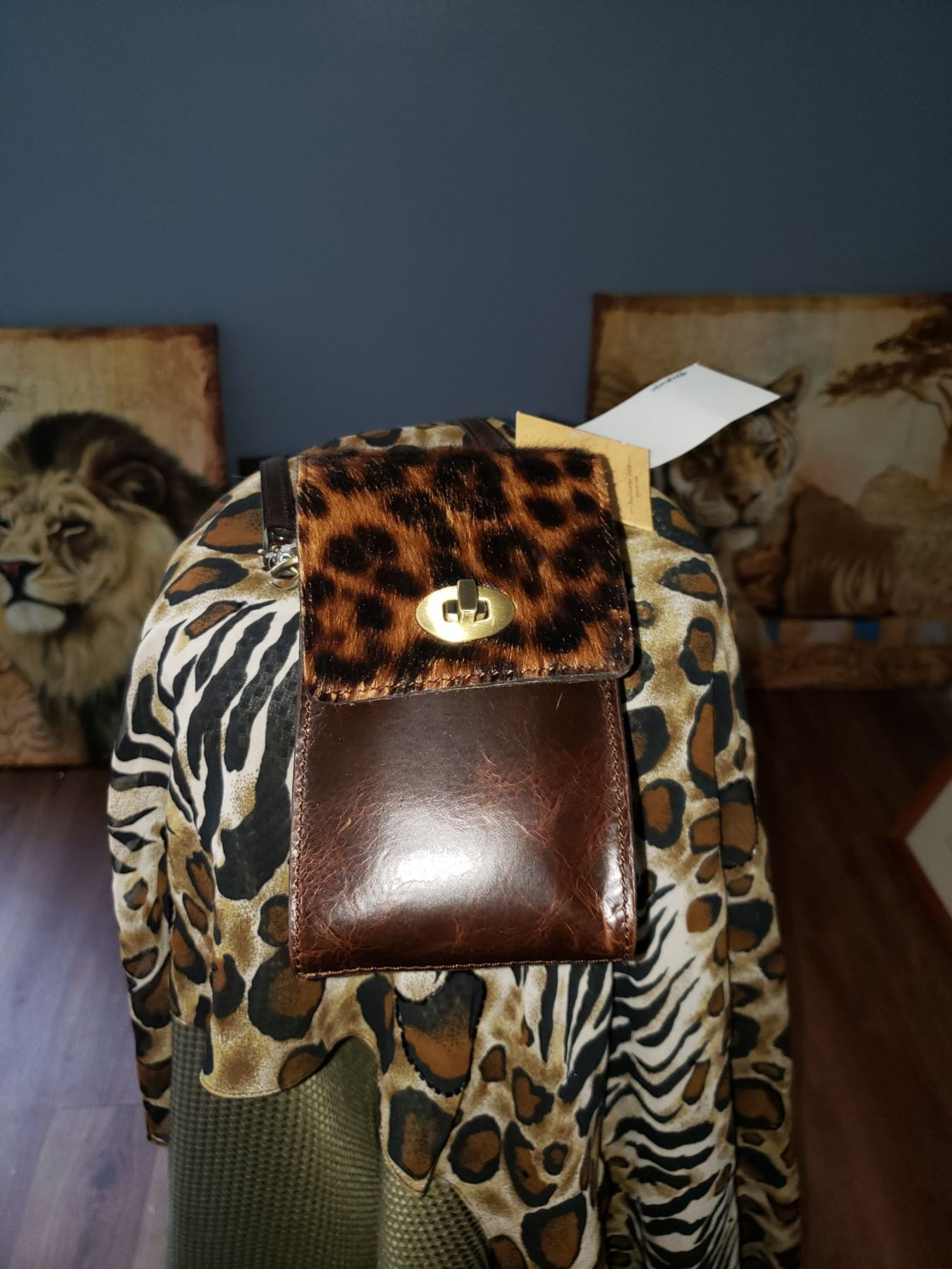 North Florida Chapter donates a Small Leather Patricia Nash Cross Body bag.