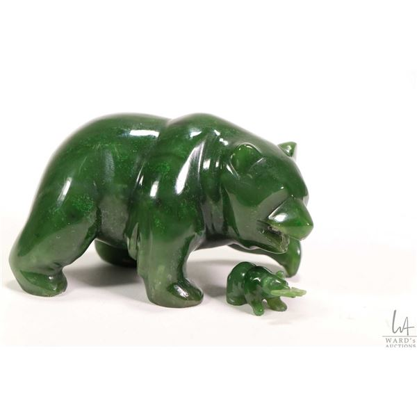 "Hand carved jade bear 2 1/4"" in height and initialled by artist, note may have once had a fish in hi"