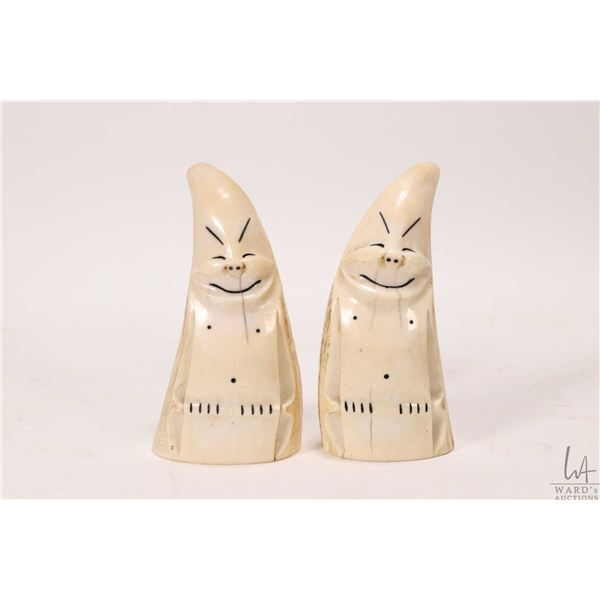 "Pair of carved Inuit walrus tusk Billiken figures, each approximately 4"" in height. CANADIAN BUYER'S"