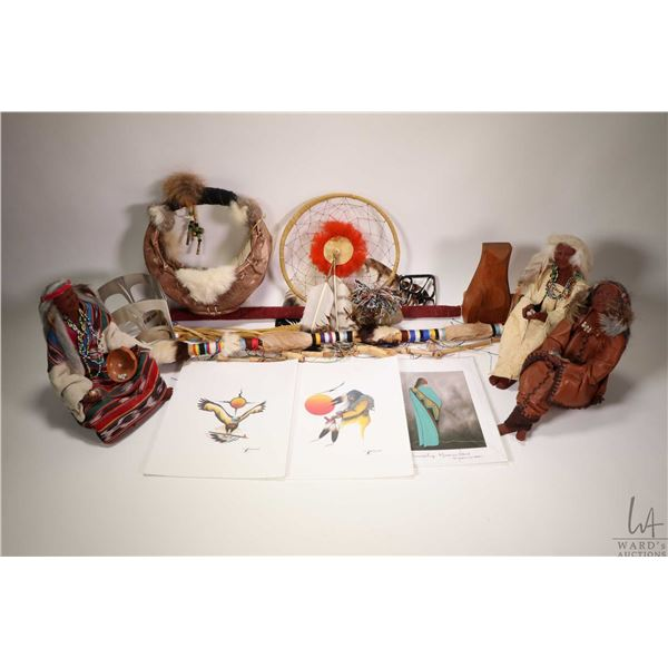 Selection of Inuit collectibles including three handmade clay dolls, basket with furs and feathers,