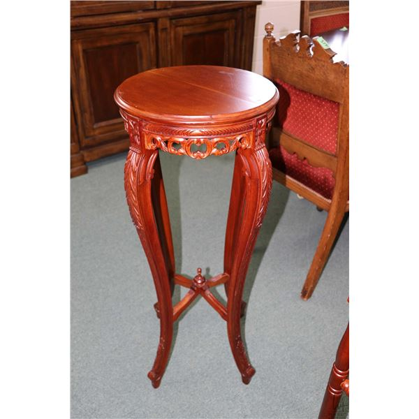 "Modern Victorian style mahogany plant stand with carved skirt and supports, 36"" in height"