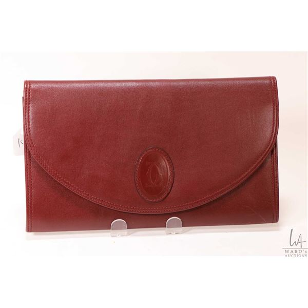 "Cartier Must de Cartier burgundy leather clutch bag 6 1/2"" X 11"""