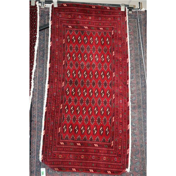 100% handmade Iranian wool scatter rug with red background and highlights of cream, brown and black,