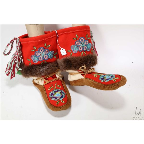 Pair of beaded suede and wool mukluks with fur trim, not sized but length of soles is 11""
