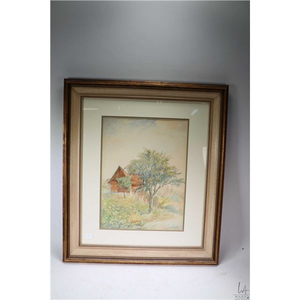Framed watercolour painting of a rural outbuilding with cathedral in background signed by artist (?)