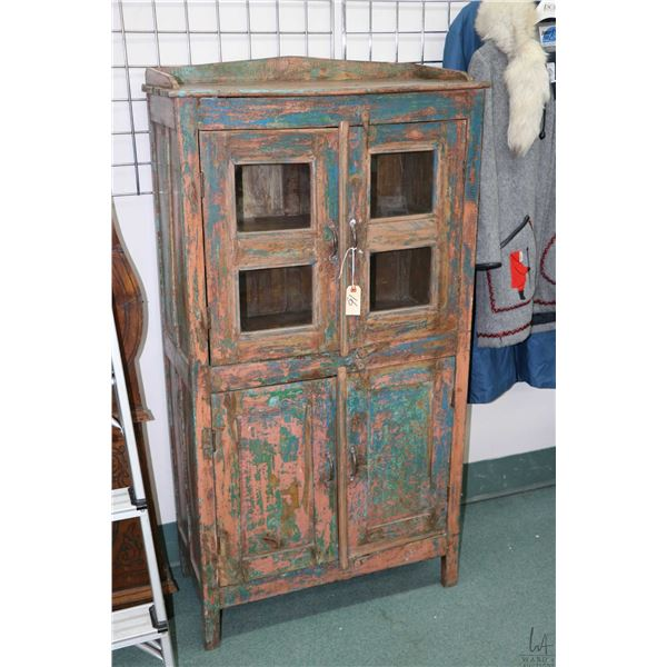 "Primitive cabinet with two glazed and two raised panel doors, 56"" high and 29"" wide"