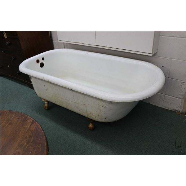 Vintage white enamel bath tub with ball and claw feet, 5' in length