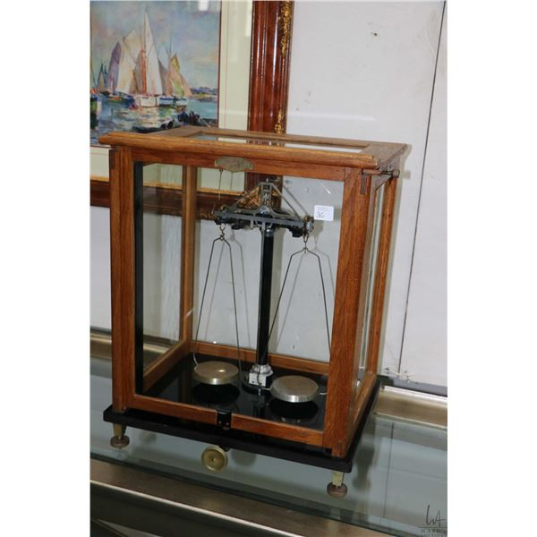Glass and oak cased Scientific balance scale made by F. Sartorius, Gottengen, overall dimensions 19""