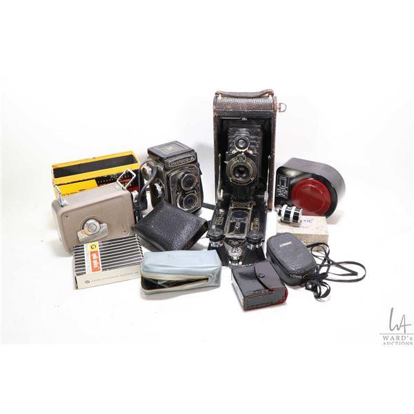 Box of vintage camera equipment including a Yaschica-A camera, a Kodak No.3-A Autographic camera, a