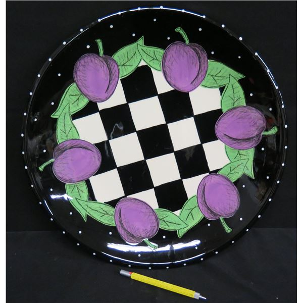 """Black Checked Plate w/ Plums, Signed Kig 99, 17"""" Dia."""