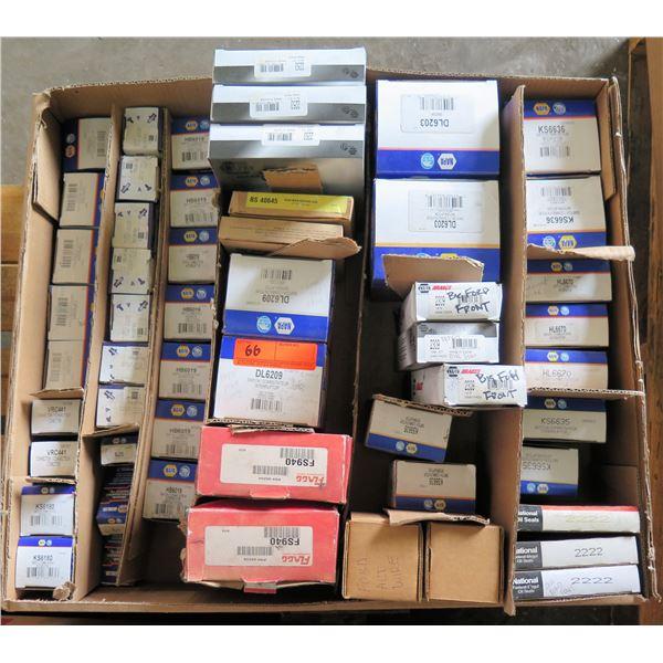 Box Multiple NAPA Seitch Interrupter, Spark Plugs, Flagg Suspension Parts, Oil Seals, etc