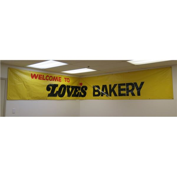 Welcome to Love's Bakery Long Yellow Banner