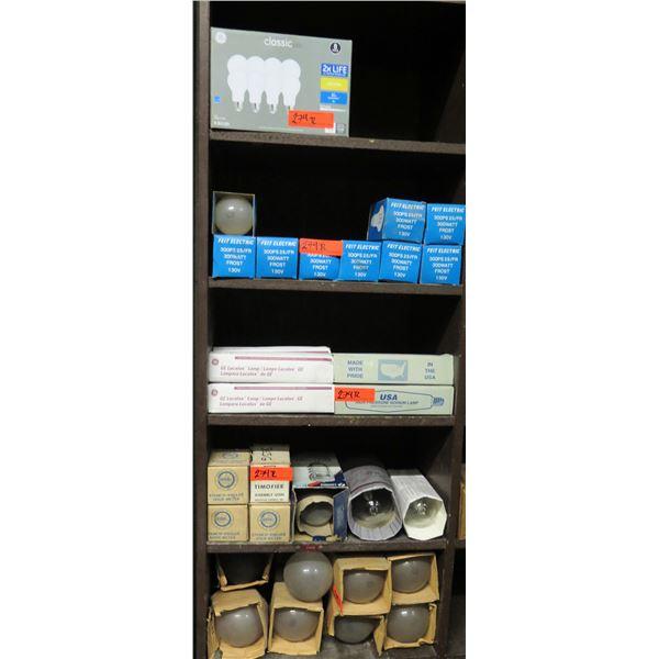 Contents of Shelf: GE Lucalox Lamps, Light Bulbs, Hour Meters, etc