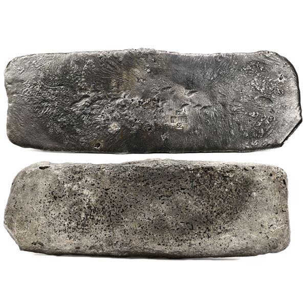 Silver  tumbaga  bar #M-115, 7.08 lb av, marked with finenesses IV IIII (1400/2400) and iUB (1500/24