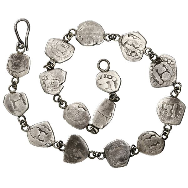 Silver bracelet made of fifteen Guatemala cob 1/2R, most with visible dates.