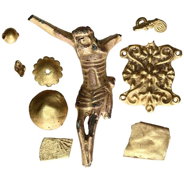 Lot of nine small gold and gilt-copper crucifix pieces, early Spanish colonial, ca. 17th century.