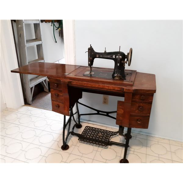 EXCEPTIONAL ANTIQUE ECONOMY BRAND SEWING MACHINE CABINET & PEDESTAL