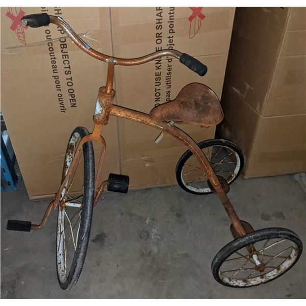 Vintage rusted tricycle needs some repair but tires are in good shape